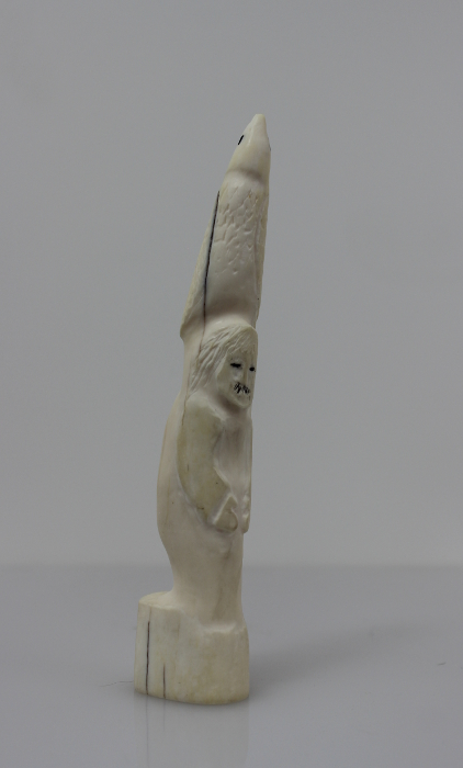 Ivory totem carved by Alexis Milortok, an Inuit artist from Naujaat, Nunavut.