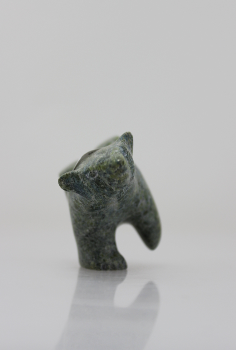 Charming little carving of a diving polar bear by Alasuaq Sharky, an artist from Cape Dorset.