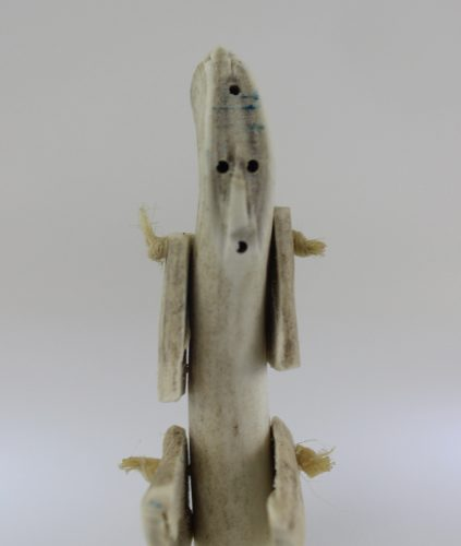 Bone person made by Sarah Iootna, an Inuk artist from Arviat, a community in Nunavut. This is a whimsical creation by a talented artist.