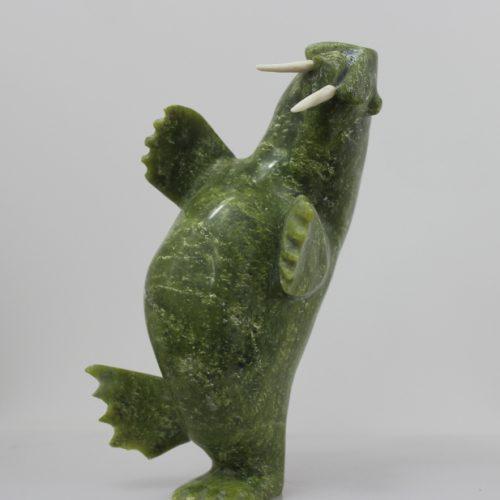 Dancing Walrus in green serpentine by Jawlee Mingeriak from Kimmirut