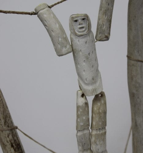 antler bone carving of Swinging Man by Thomas Aniksak from Arviat